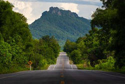 Bumpy asphalt road on hill in Lampang Thailand