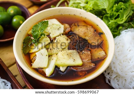 Bun cha is a Northern Vietnamese noodle with grilled pork served with fresh herbal.  Us President, Obama used to try this food in Ha Noi when visiting Vietnamese Capital in 2016.