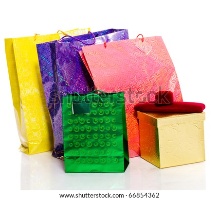 Bunch colorful paper bags for gifts isolated on white