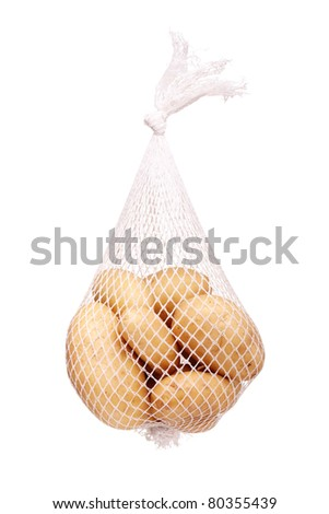 bunch fresh potatoes in a white mesh bag