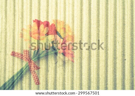 bunch of artificial flower on crepe paper background ,vintage tone