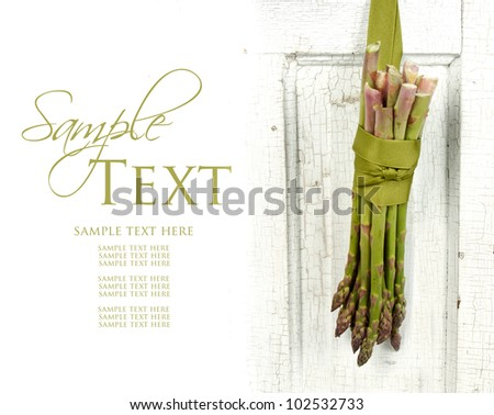 Bunch of asparagus hanging on a vintage or antique door