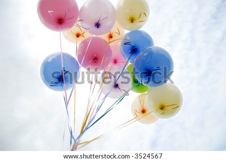 Bunch of balloons against the sky