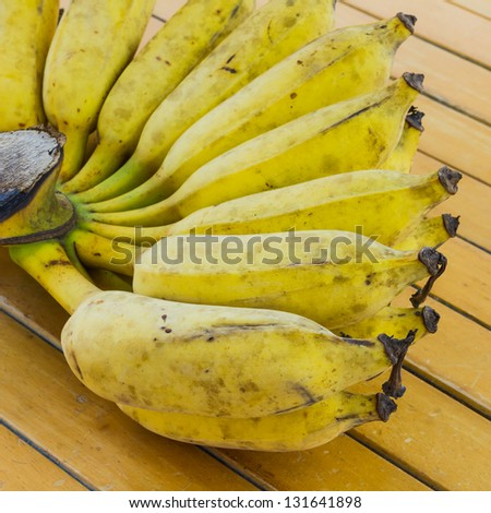 Bunch of banana on wooden table
