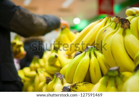 Bunch of bananas on boxes in supermarket
