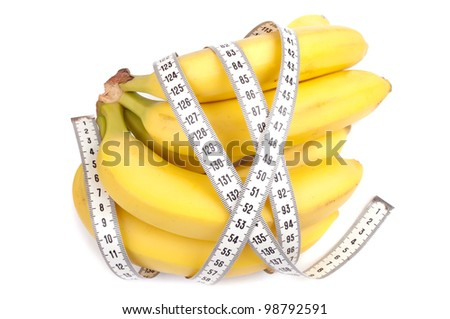 Bunch of bananas wrapped with centimeter tape, isolated on white