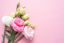 Bunch of beautiful eustoma flowers on pink background