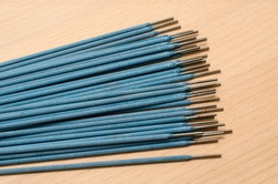 bunch of blue coated welding electrodes