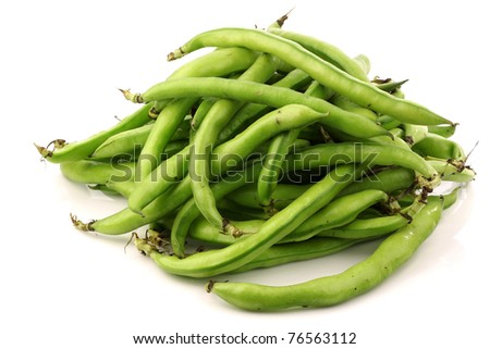 bunch of broad beans on a white background