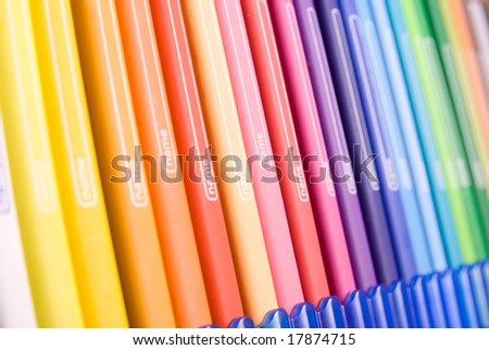 Bunch of colorful pencils with name tag on them.