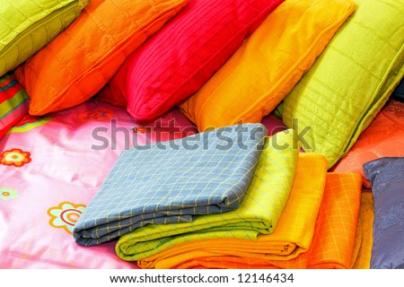 Bunch of colorful pillows and blankets for bed