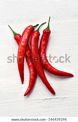 Bunch of colorful red hot chili peppers used as a pungent flavoring and spice in cooking