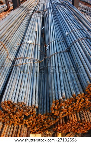 Bunch of concrete reinforcement steel rods in warehouse
