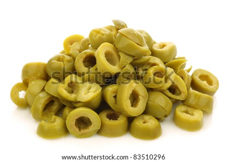 bunch of cut green olive rings on a white background