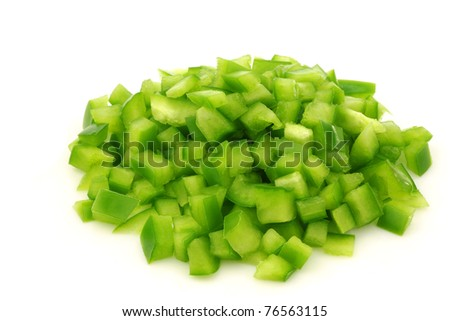 bunch of cut pieces of green paprika (capsicum) on a white background
