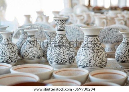 Bunch of different pattern clay  jars and pots made by greek artists ready to be painted