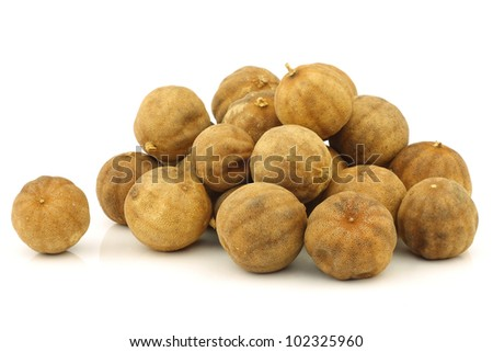 "bunch of dried ""white lime"" fruit on a white background"
