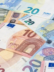 Bunch of euro banknotes. Many Euro bills lie on top of each other. Pile of money of the European Union. Currency of the united Europe. Cash balance of the European Central Bank or ECB. Portraits align