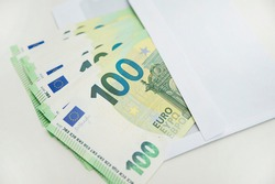 Bunch of Euro's. Close-up. Saving money. Keeping savings at home. Open envelope with Euro banknotes out from it. Finance, savings, investing. Money management at home. Financial business concept.