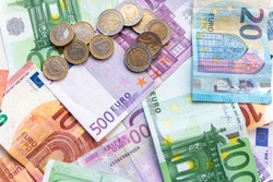Bunch of european money with coins and bank notes show international finance with euro and europe, bets and wins or financial success as well as credit management and professional banking