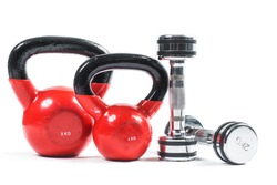 Bunch of fitness training weights isolated on white background. Dumbbells, kettlebell.