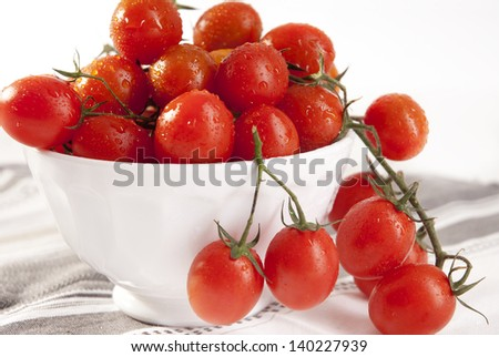 Bunch of fresh cherry tomato in a bowl