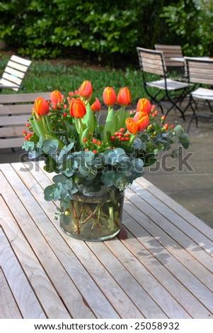 bunch of fresh cut tulips (Liliaceae) on garden table, Public Garden Keukenhof, Netherlands, Europe