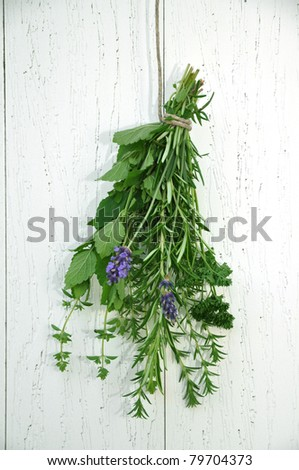 Bunch of fresh herbs, hanging on a rope to dry