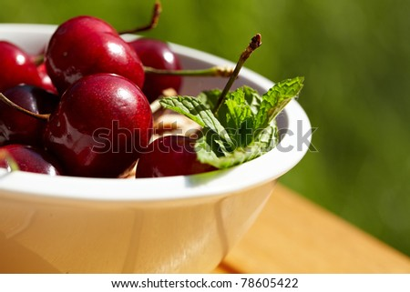 bunch of fresh,juicy, ripe cherries, shallow dof