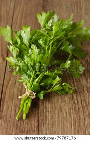 Bunch of fresh parsley on a wooden garden board.