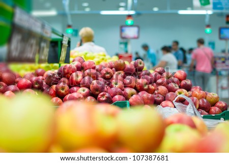 bunch of fresh red apples in supermarket