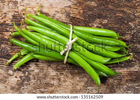 bunch of garden beans on wood