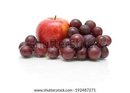 bunch of grapes and red apple close up on a white background. horizontal photo.