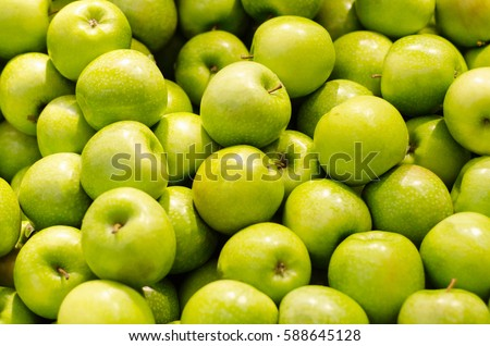 Bunch of green apples in supermarket