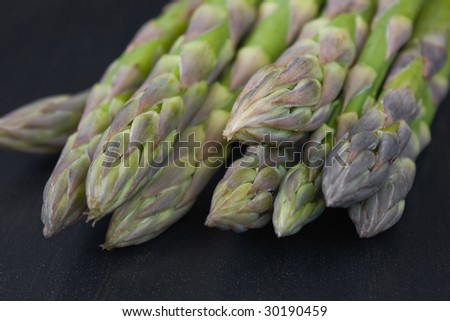Bunch of green asparagus on dark back ground