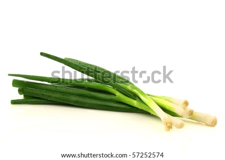 bunch of green onions on a white background