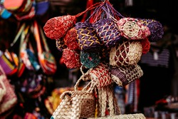 Bunch of handmade purses made from natural Abaca plant. Animal free. Selective focus.