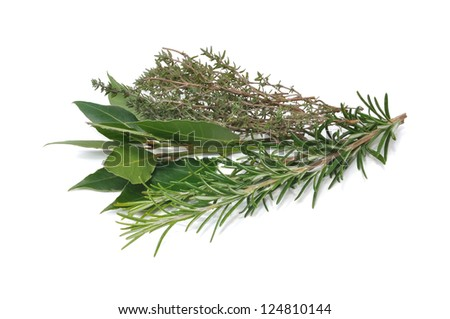 bunch of herbs composed of rosemary, thyme and bay leaves isolated on white background