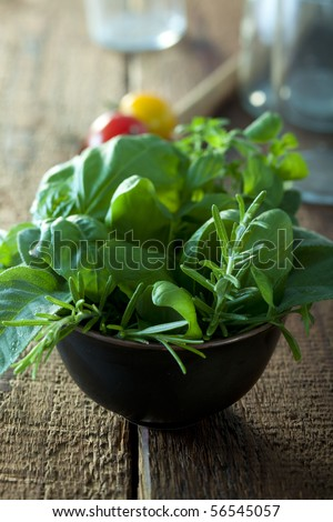 bunch of herbs in a small bowl