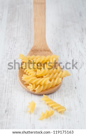 Bunch of italian fusilli pasta on wooden spoon