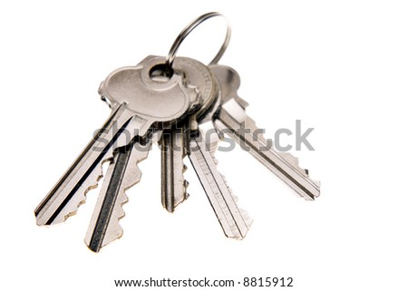 Bunch of keys isolated over white - stock photo