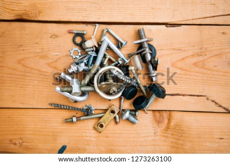 Bunch of metalware on a wooden ground, flat lay (top view) #1273263100