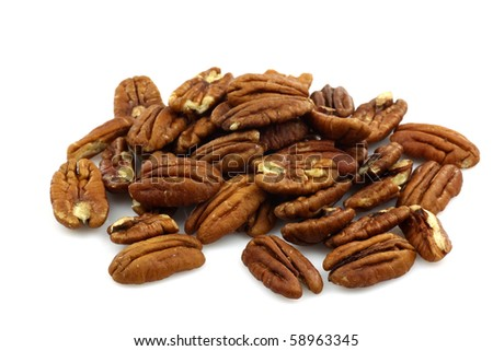 bunch of pecan nuts on a white background