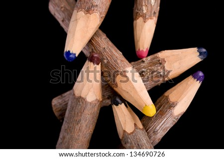 bunch of pencils stylized tree branch. isolated on the black
