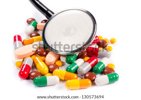 bunch of pills on white background