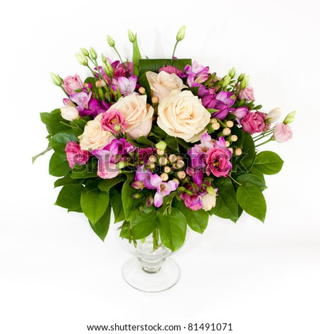 bunch of pink and creamy flowers  in glass vase