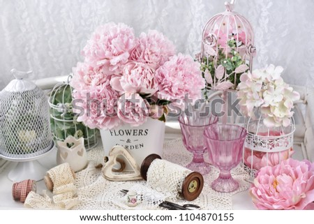 bunch of pink peony flowers in metal bucket in shabby chic style interior #1104870155