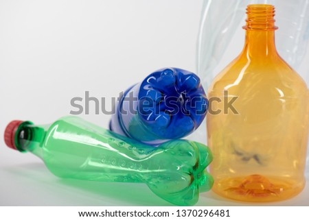 Bunch of plastic. Colorful plastic bottles placed on the white surface and representing world problems #1370296481