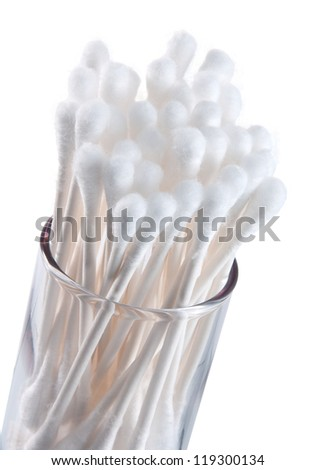 Bunch of q-tips in jar and table