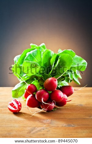 bunch of radishes on wooden